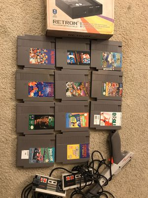 Retron NES system new in box with 11 Nintendo games and more for Sale in Seattle, WA