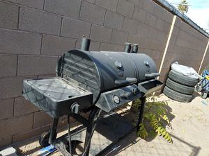 Selling my Barrel BBQ Pit with smoker and Grill set up for propane or charcoal for Sale in North Las Vegas, NV