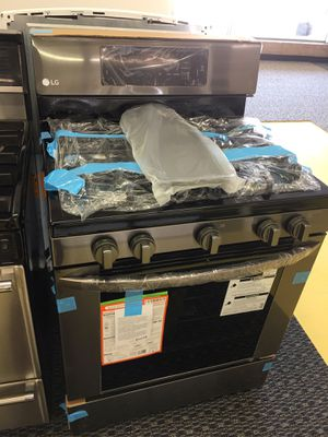 Brand New LG black Stainless Steel Gas Stove With Comal No Credit Needed Just $39 De Enganche You Take Home for Sale in Garland, TX