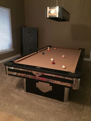 8' pool table with matching light and pool sticks for Sale in Hesperia, CA