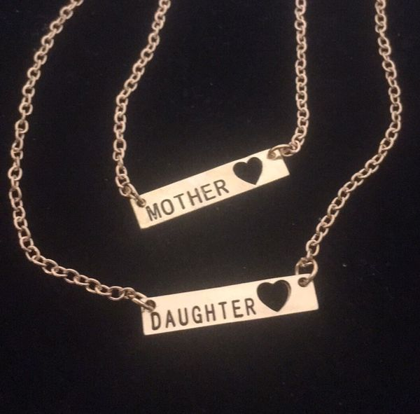 Gold colored mother daughter set.