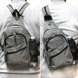 Brand NEW!Grey Small Crossbody/Side Bag/Sling/Pouch Converts To Backpack Style/For Work/Traveling/Outdoors/Hiking/Biking/Parties/Sports/Gym for Sale in Carson,  CA