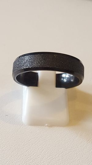 Brand new. 4 mm jet black rings. Sizes 7 through 12 available. Never Fade. Never tarnish. Hypoallergenic. Solid stainless steel guaranteed. for Sale in St. Louis, MO