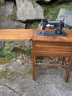 Kennore Sewing Machine And Cabinet Vintage for Sale in Seattle,  WA