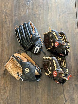 4 baseball gloves and 4 bats $85.00 for Sale in El Mirage, AZ