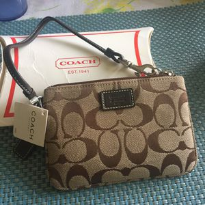 Authentic Brown and black coach monogram wristlet for Sale in West Los Angeles, CA