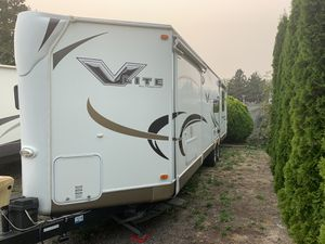 2012 V lite by Flagstaff travel trailer 30 ft (With 3 slide outs) for Sale in Edgewood, WA