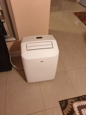 LG Electronics 8,000 BTU Portable Air Conditioner, 115-Volt w/ Dehumidifier Function and LCD Remote in White for Sale in Lauderhill, FL