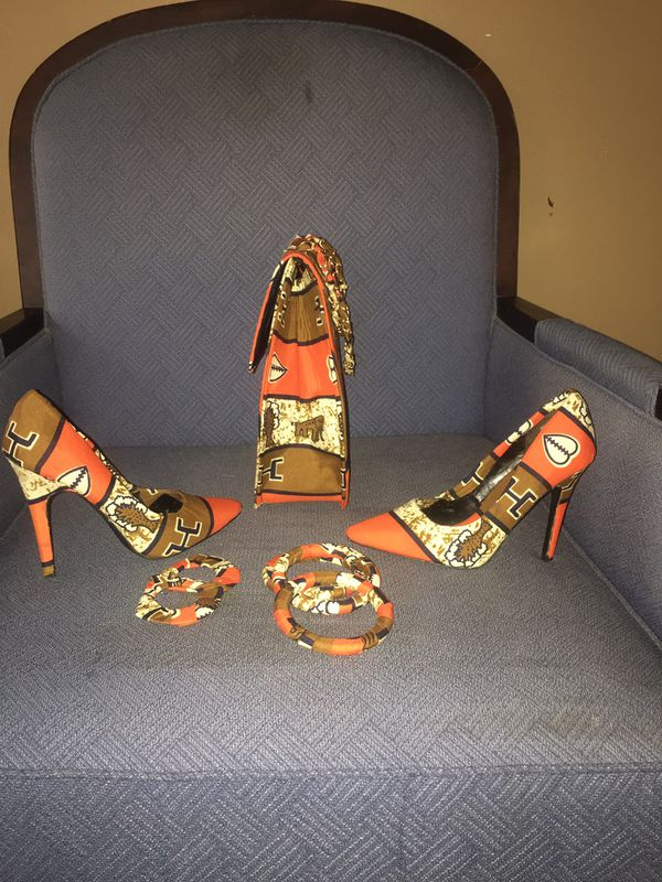 Lady's handbag,high heel shoes;earrings and bangles All of them made with African cloth materials.New:never used