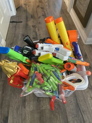 Nerf Guns Galore!!! A bucket of Nerf Gun , Amo, and 2 vests. Also, 2 lazer gun for Sale in Dana Point, CA