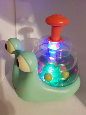Bundle pack of 3 baby toys- snail push toy lights up, Chico push toy and rainbow stacker for Sale in HOFFMAN EST, IL