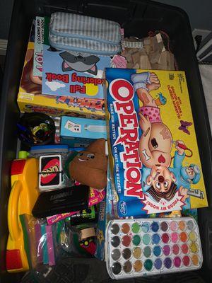 50 gal storage bin full of games for Sale in Orange, CA