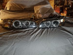 97-03 Pontiac grand prix halo headlights and 2 rims. for Sale in Burbank, IL