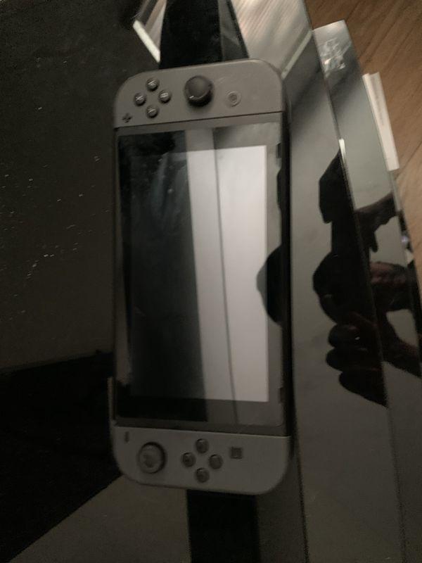 Nintendo Switch with Joy Cons + Dock + Pro Controller + Super Smash