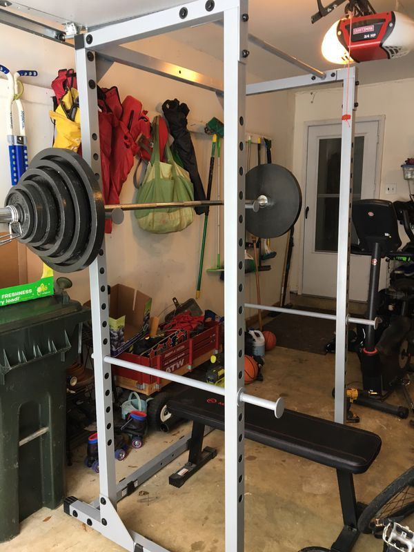 Squat rack and Olympic weight set