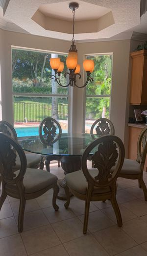 """60"""" round glass kitchen table set with 6 chairs and corner cabinet piece for Sale in Boynton Beach, FL"""