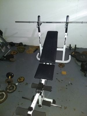 Versatile weight bench by Kettler with a height adjustable barbell support for bench press for Sale in Hampton, VA