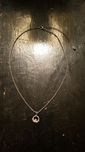Hands holding heart silver charm necklace for Sale in Columbus, OH