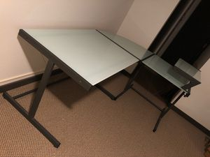 L-shaped glass office desk with a shelf for Sale in Seattle, WA