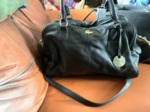 Lacoste leather purse for Sale in Martinsburg, WV