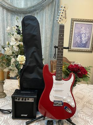 red huntington guitar package with amp cable case strap and guitar picks for Sale in South Gate, CA