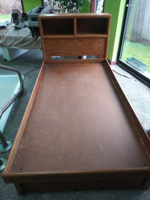 Wooden twin bed frame with two drawers and headboard for Sale in Kent, WA
