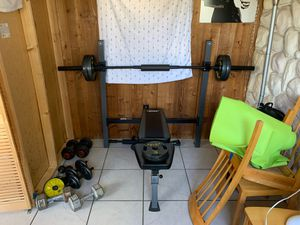 Adjustable Workout Bench. With 45lbs Bar, 4/25lbs, 2/10lbs, 2/5lbs included for Sale in Hollywood, FL