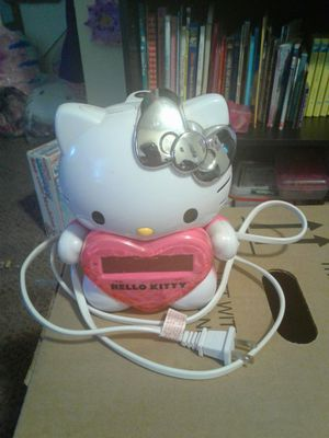 Hello Kitty alarm clock radio with ceiling projector, first aid kit, walkie talkie & earmuffs & glove set. for Sale in Levittown, PA