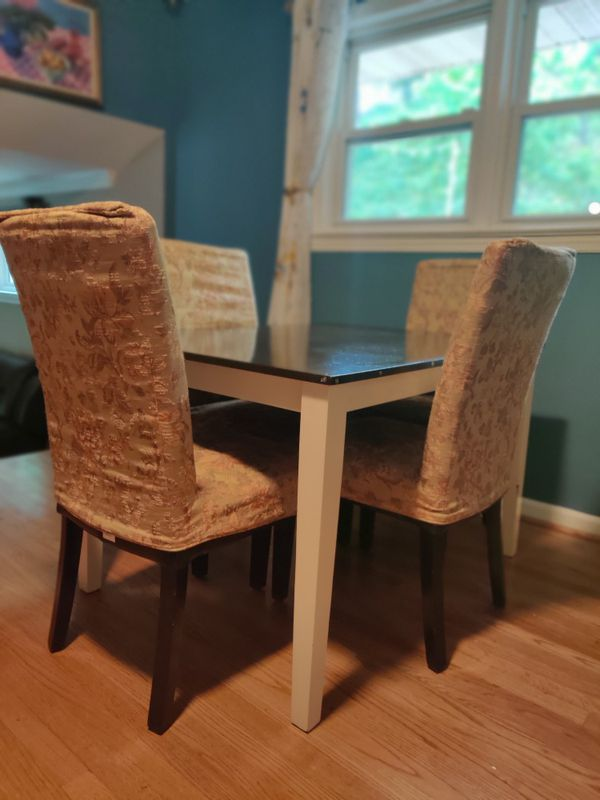Dinning table and 4 chairs with cover .