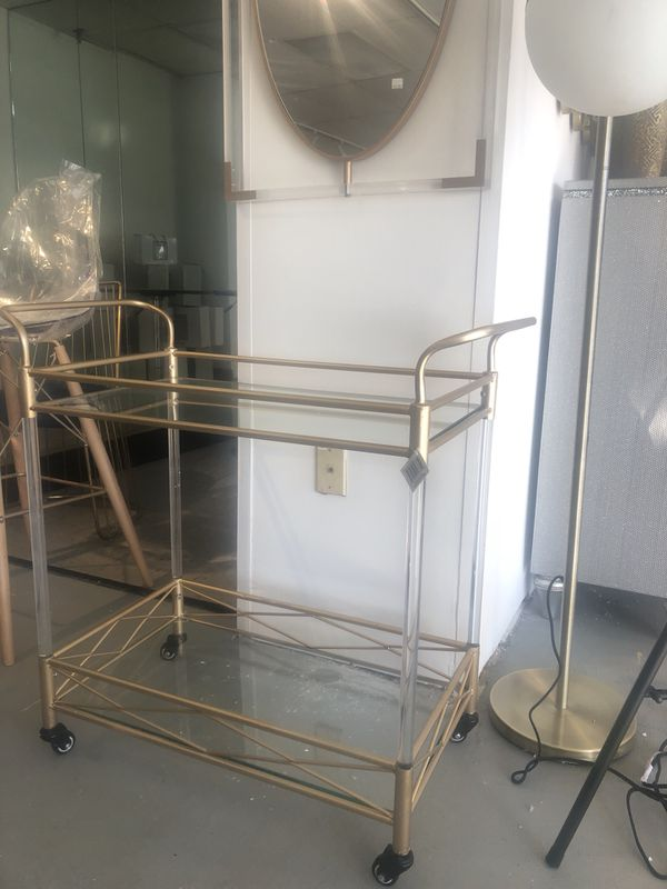 Acrylic bar cart and acrylic and gold mirror