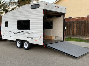 """2004 Titan toy hauler 22/ft Tongue Weight: 735lbs Driveway 3600 lbs 10'10"""" to the first cabinet 96 inches between walls Fresh Water Capacity: 40 G for Sale in Fresno, CA"""
