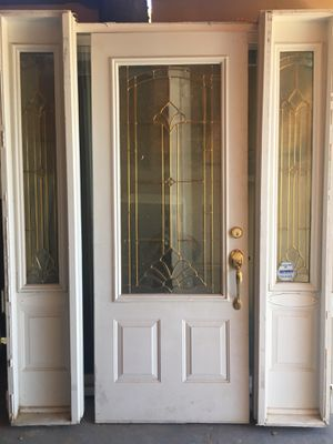 ENTRY DOIR N SIDE LIGHTS STANDARD ENTRY DOOR SIZE NO JAM IR FRAME USED CONDITION for Sale in Phoenix, AZ