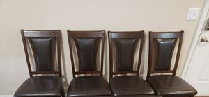 4 chairs and a solid wood table for Sale in Dallas, TX