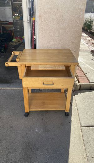 Kitchen island with drawer, cutting board, wine rack, and knife holder for Sale in Hawthorne, CA