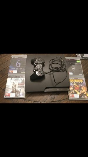PS3 slim and 4 games for Sale in Rockville, MD