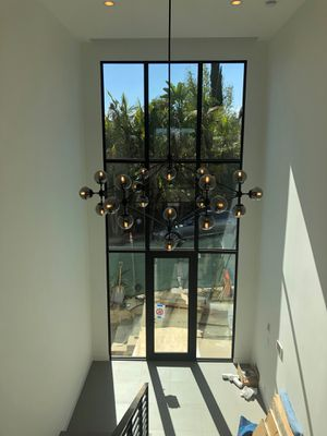 Glass black chandelier 21 glass balls new in box for Sale in West Hollywood, CA