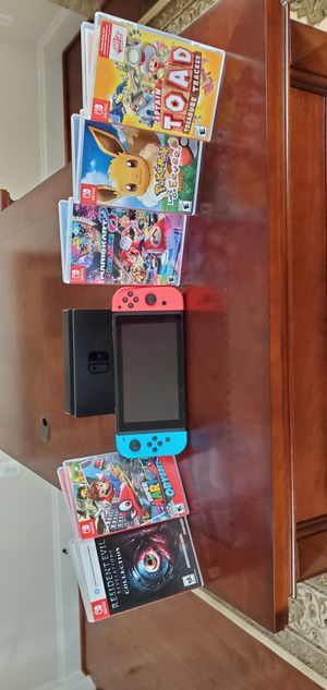 Nintendo Switch with 5 games (firm price) for Sale in Stone Ridge, VA