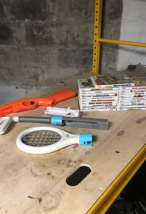 19 Wii games , hunting shotgun , Nerf tennis racket and golf club , and fishing real for Sale in New Brighton, PA