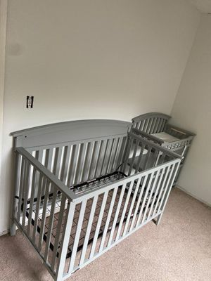 Gray crib and changing table for Sale in Stockton, CA