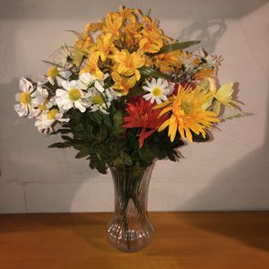 NEW WITH TAGS five sets of bright & beautiful artificial flowers in a large clear vase. The flowers could also be used for making crafts too for Sale in Saint Albans, WV
