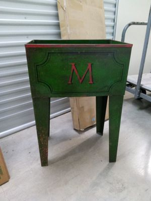 "Metal Planter green with large M insignia on front 26"" tall 18x 12 for Sale in Jacksonville, FL"