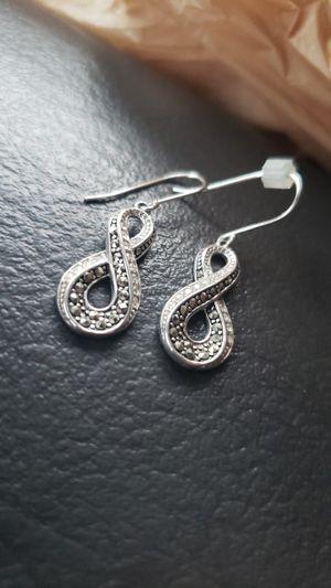 SS Infiniti Earrings for Sale in Traverse City, MI