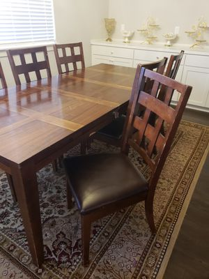 Long wooden dining table with leather chairs for Sale in Happy Valley, OR