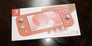 Nintendo switch lite coral for Sale in Sacramento, CA