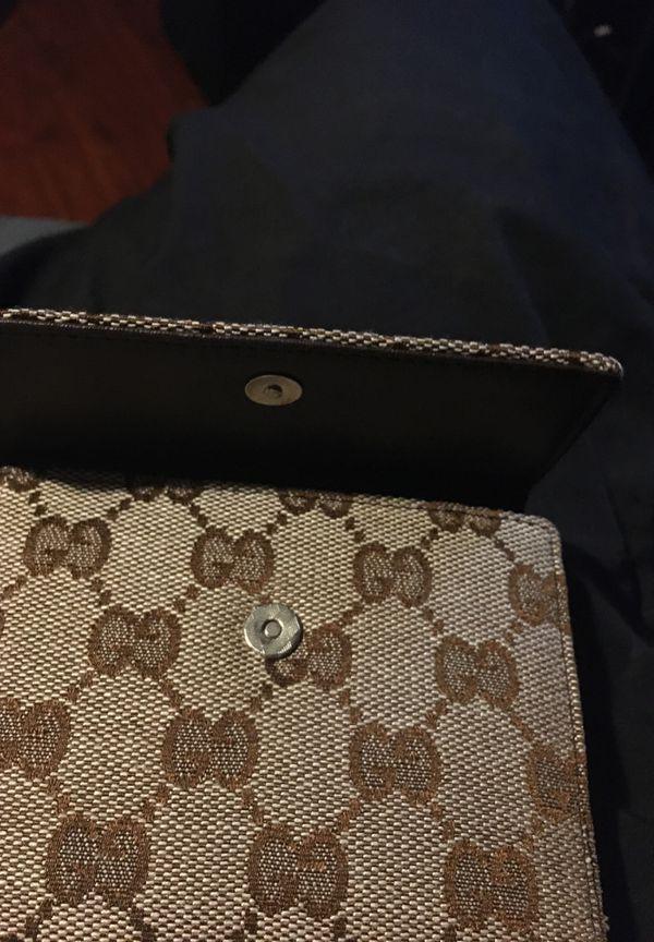 Brown Gucci wallet