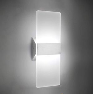 Brand new (still in packaging) beautiful, wired wall sconce light in silver finish for Sale in Kent, WA