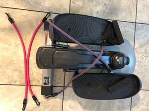 Elliptical machine with resistance bands for Sale in Saint Petersburg, FL