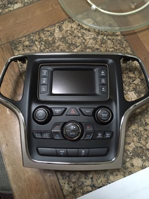 Jeep Grand Cherokee Bezel with Satellite radio Bluetooth Backup Camera car auto parts for Sale in Hinsdale, IL