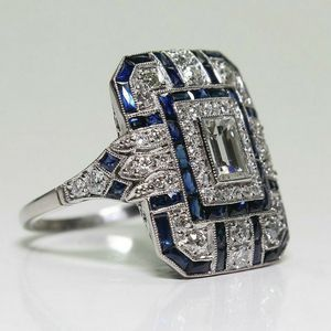 White and blue Sapphires channel set on large Noble square setting silver plated sz 7 for Sale in Northfield, OH