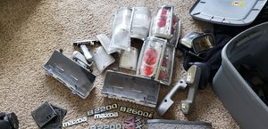 Mazda b series parts parts are pictured clear tailights are sold.. for Sale in Puyallup, WA